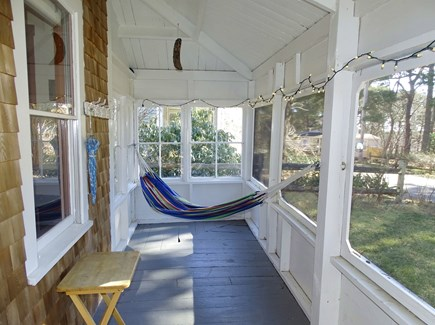 Wellfleet Cape Cod vacation rental - Inviting wrap around 3-seasons porch with hammock
