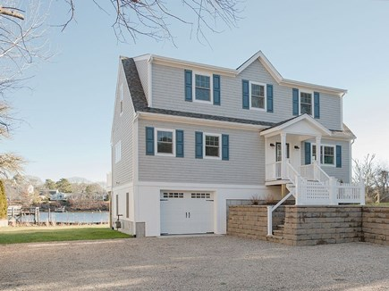West Dennis Cape Cod vacation rental - Front of new house.  Trex Deck along entire back/riverside.