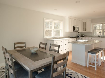 West Dennis Cape Cod vacation rental - Kitchen with granite, hardwood floors and stainless steel.