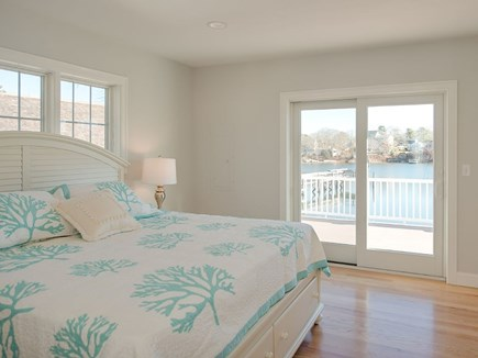 West Dennis Cape Cod vacation rental - Master with slider to deck, views and kingsize bed.