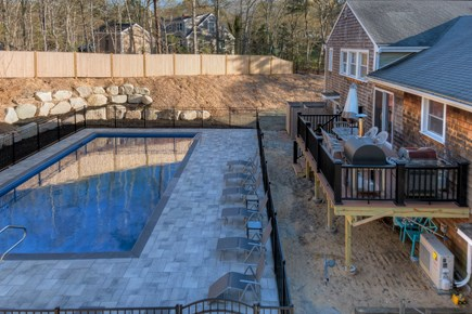 Eastham Cape Cod vacation rental - Back yard with new pool, and new deck overlooking the yard.