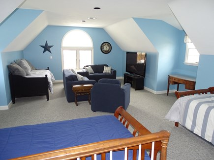 Mashpee, Popponesset Cape Cod vacation rental - Upstairs bedroom for kids with living area and flat screen TV