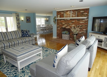 Mashpee, Popponesset Cape Cod vacation rental - Living room enters into dining and kitchen areas