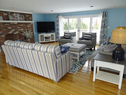 Mashpee, Popponesset Cape Cod vacation rental - Spacious living room with slider to deck, flat screen TV