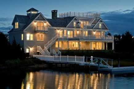 West Yarmouth Cape Cod vacation rental - Back view with dock, great for boating or swimming