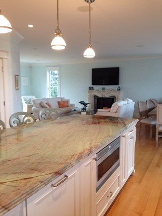 West Yarmouth Cape Cod vacation rental - Kitchen looking into living room, large tv & fireplace