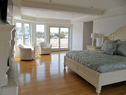 West Yarmouth Cape Cod vacation rental - Master bedroom with tv, fireplace, sliders to deck front and back