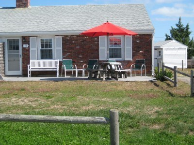 West Dennis Cape Cod vacation rental - Front of house with patio and additional seating