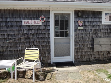 West Dennis Cape Cod vacation rental - Back door to outdoor shower and more outdoor seating