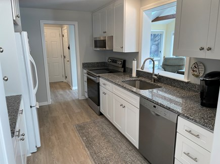 Orleans Cape Cod vacation rental - New kitchen with adjacent first floor laundry area.