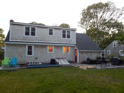 Falmouth Cape Cod vacation rental - Rear of house, big flat yard, big deck, chairs, tables and shower