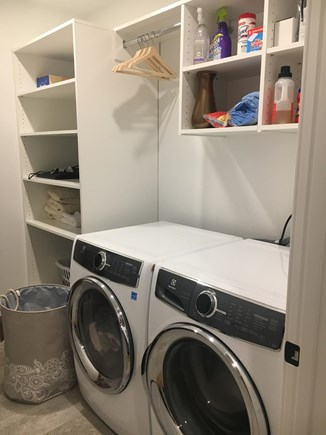 Wellfleet Cape Cod vacation rental - 1st floor laundry room with Electrolux washer, steam dryer, iron.