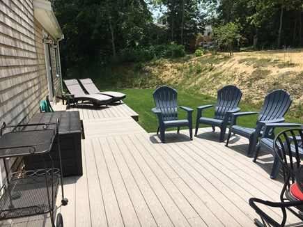 Wellfleet Cape Cod vacation rental - Private, sunny backyard, outside shower, Weber grill, table set.