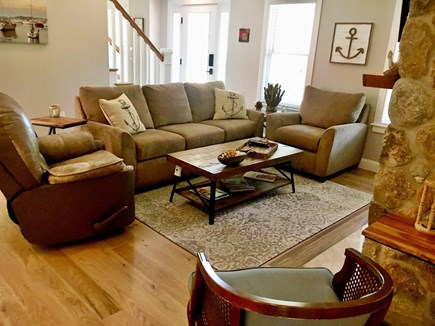 Wellfleet Cape Cod vacation rental - Open living room with gas stone fireplace, reclining rocker.