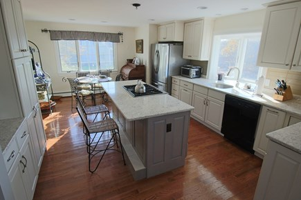 East Dennis Cape Cod vacation rental - Kitchen with granite & dining area beyond