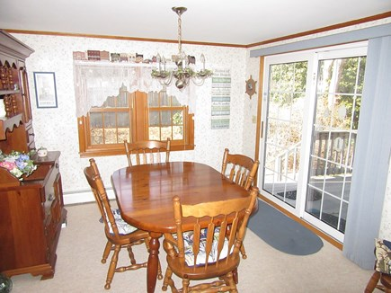 South Dennis Cape Cod vacation rental - Dining room off kitchen with slider to deck