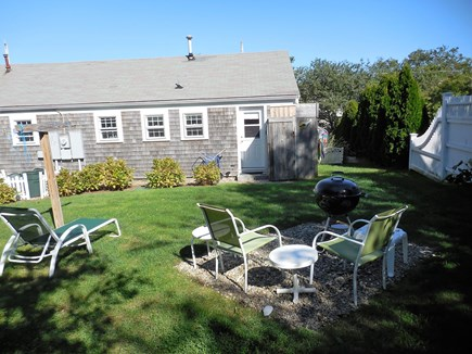 Dennis Cape Cod vacation rental - Fenced back yard- outside hot/cold shower - BBQ area- clothesline