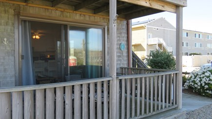 Provincetown Cape Cod vacation rental - Front Porch with four seat dining table.