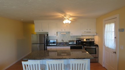 Provincetown Cape Cod vacation rental - Kitchen with granite counters and granite center bar with seating