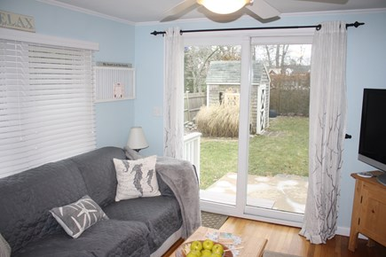 Dennis Cape Cod vacation rental - Den with sliders to back yard