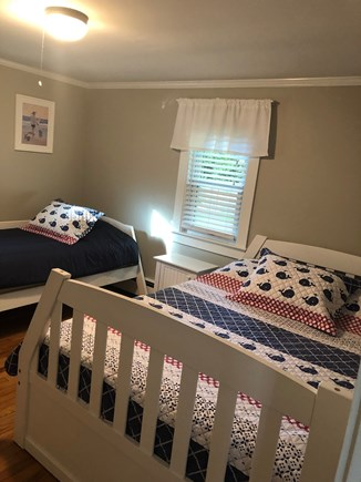West Yarmouth Cape Cod vacation rental - Bedroom -a double bed & a single bed along with a bureau & closet