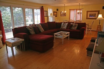 Harwichport Cape Cod vacation rental - Large family/dining room with 12 foot French slider to deck.