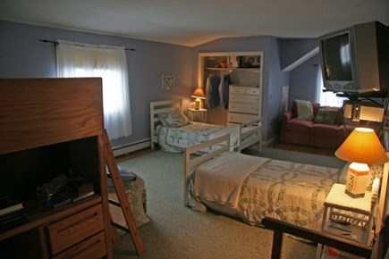 Harwichport Cape Cod vacation rental - 2nd floor bedroom with 2 twins, bunk bed, and queen sofa bed.