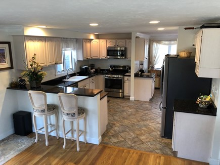 Dennis Cape Cod vacation rental - The kitchen has seating at the counter, too.
