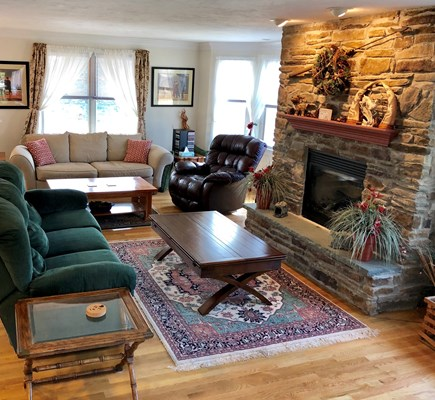 Dennis Cape Cod vacation rental - The Living Room area and fireplace. There are a lot of windows!