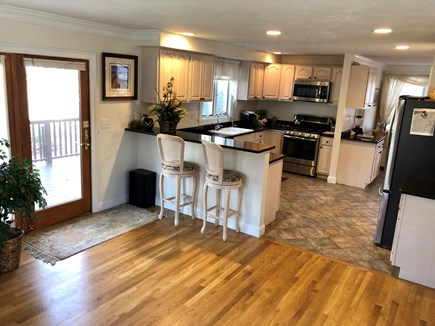 Dennis Cape Cod vacation rental - The kitchen features new stainless steel appliances with granite.