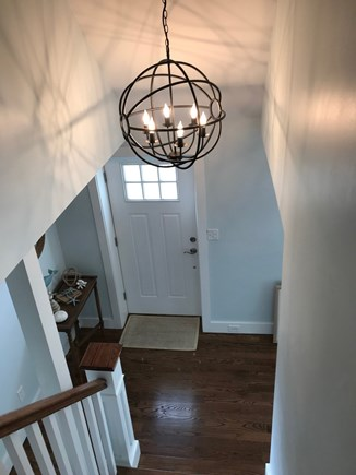 Falmouth Cape Cod vacation rental - Upstairs looking down at front door and foyer