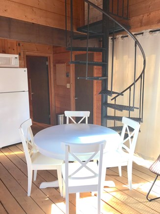 Wellfleet Cape Cod vacation rental - Dining inside with stairs up to loft bedroom