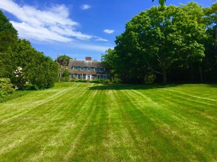 Harwichport, just across from  Cape Cod vacation rental - Rolling front lawn with patio, many beautiful trees and flowers.