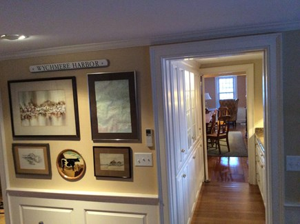 Harwichport, just across from  Cape Cod vacation rental - View from kitchen into dining room. Bar area with numerous dishes