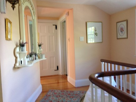 Harwichport, just across from  Cape Cod vacation rental - Hallway invites you to the upper three bedrooms.