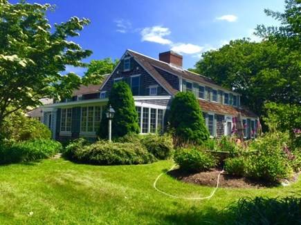 Harwichport, just across from  Cape Cod vacation rental - Side view near the gated Koi pond and patio.