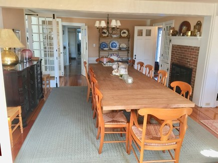 Harwichport, just across from  Cape Cod vacation rental - Dining room with fireplace and table that seats twelve or more.