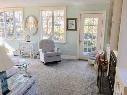 Harwichport, just across from  Cape Cod vacation rental - Sun room with the third of the four fireplaces on the first floor