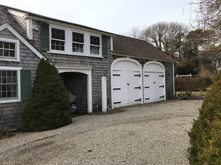Harwichport, just across from  Cape Cod vacation rental - Garage with mew leading to the private yard abound with flowers.