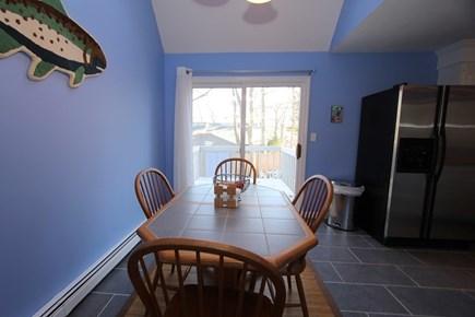Mashpee Cape Cod vacation rental - Kitchen Table w/ Slider to Back Deck