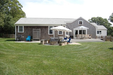 Orleans Cape Cod vacation rental - Outdoor lounge area with fire pit, plenty of seating and umbrella