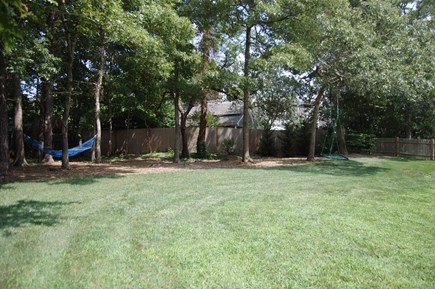 Orleans Cape Cod vacation rental - Huge fully fenced in backyard with hammock and swings