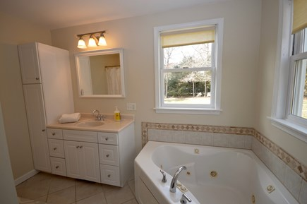 Orleans Cape Cod vacation rental - Master bath with jacuzzi tub and stand up shower