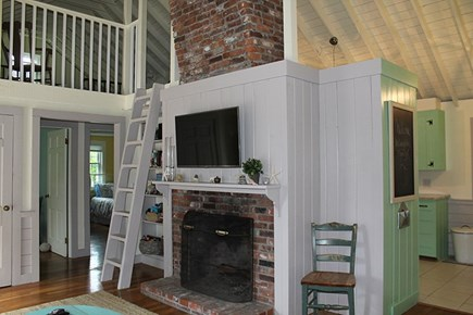 Falmouth Cape Cod vacation rental - Living room with fireplace and ladder access to loft