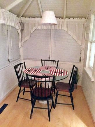 Harwichport Cape Cod vacation rental - Porch with table and chairs