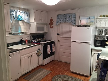 Harwichport Cape Cod vacation rental - Kitchen and door to back deck with grill and outdoor shower