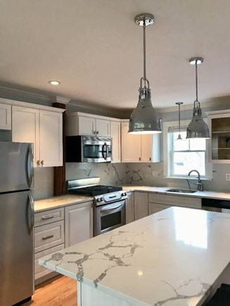 Provincetown Cape Cod vacation rental - Kitchen with marble counters, center island