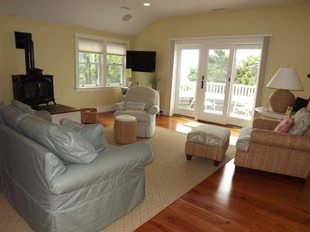 Chatham Cape Cod vacation rental - Upstairs master suite living area with balcony and views.