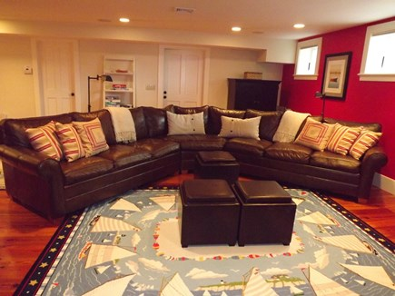 Chatham Cape Cod vacation rental - Lower level living area with tv, pull-out sofa and 2 twin beds.