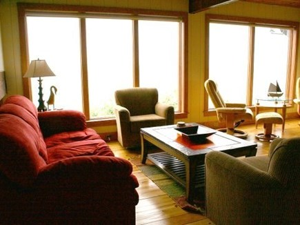 Truro Cape Cod vacation rental - Living area with water views, deck access
